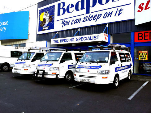 painters van outside completed paint job in Auckland